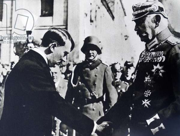 Paul von Hindenburg shaking hands with Adolf Hitler