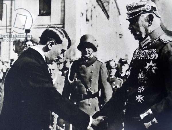 Paul von Hindenburg shaking hands with Adolf Hitler