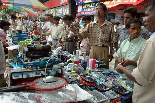 Foreign goods are sold at the footpath of Kolkata. India. July 18, 2007.  (photo)