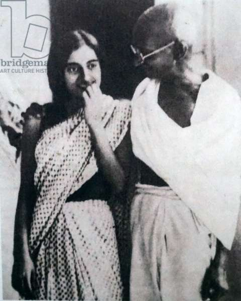 Mahatma Gandhi walking with Indira Nehru