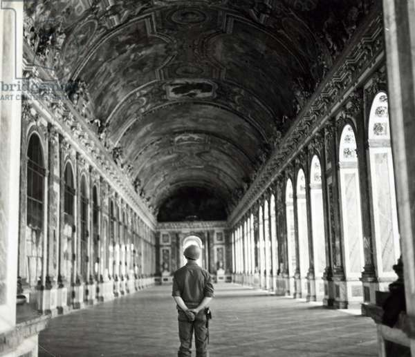 American soldier in Versailles standing in the hall of mirrors, 1944