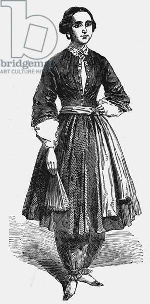 Amelia Bloomer (1818-1894) American feminist and champion of dress reform, wearing her new dress for women. This was the original from which Rational cycling dress for women grew. Bloomers was the name later applied to any baggy female nether garments. Wood engraving 1851.