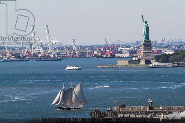 Statue of Liberty, as seen from the Brooklyn Bridge, New York City, New York, United States (photo)