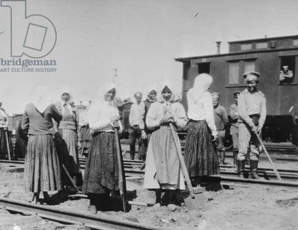 Russian women work on railway tracks.