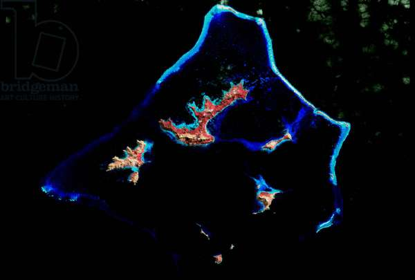 Coral reef photographed by NASA's Landsat 7 satellite. Credit NASA. Science Geology Oceanography