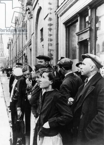 Moscow Residents Listening to a Radio Report by Molotov Announcing the Invasion of the Soviet Union by Germany, June 22, 1941.