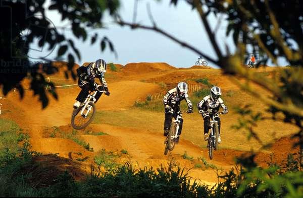 Mountain bikers, Scott Edgworth, Toby Forte, Ian Gunner, riding the man made humps in unicen.
