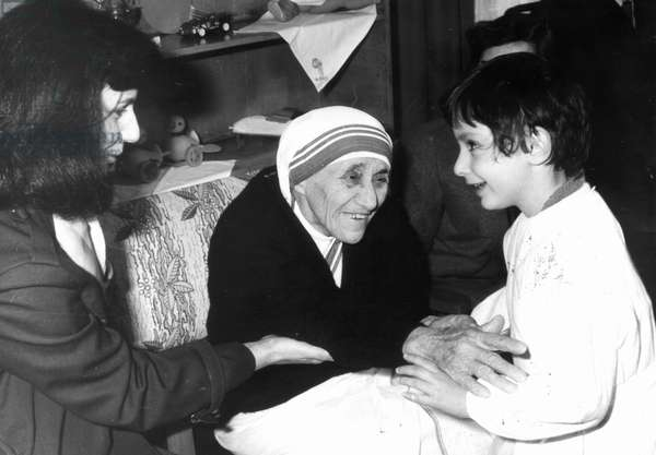 Mother Teresa Meets With Children From The 'Mother Teresa' Kindergarten In Tirana, Albania In 1990.