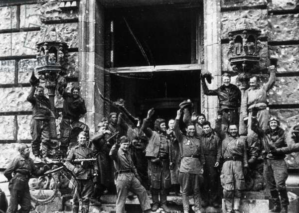 Soviet Red Army Soldiers Celebrating Outside the Reichstag (Chancery) Building, Fall of Berlin, May 1945, World War 2.