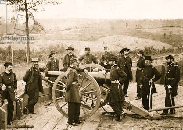 Atlanta, Ga. Gen. William T. Sherman, leaning on breach of gun, and staff at Federal Fort No. 7 1864 (photo)