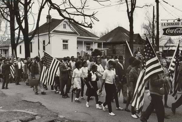 Participants, some carrying American flags, marching in the civil rights march from Selma to Montgomery, Alabama in 1965 1965 (photo)