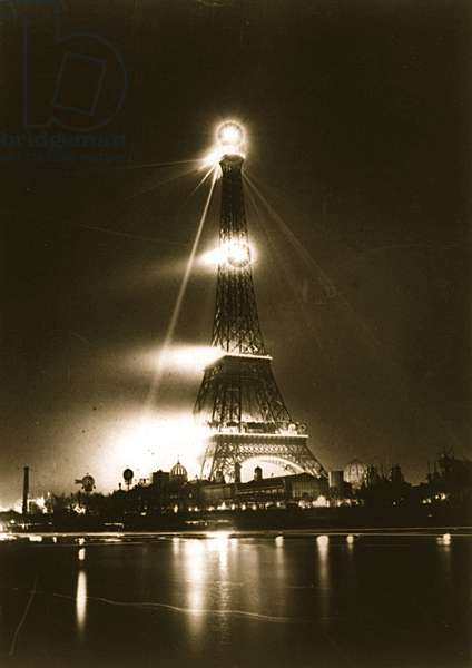 Illuminated Eiffel Tower at Night 1890 (photo)