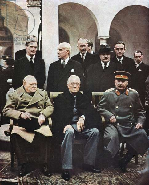 Yalta Conference of Allied leaders, 4-11 February 1945. Seated left to right: Churchill, FD Roosevelt and Stalin with their respective foreign ministers behind them, Eden, Stettinius and Molotov.