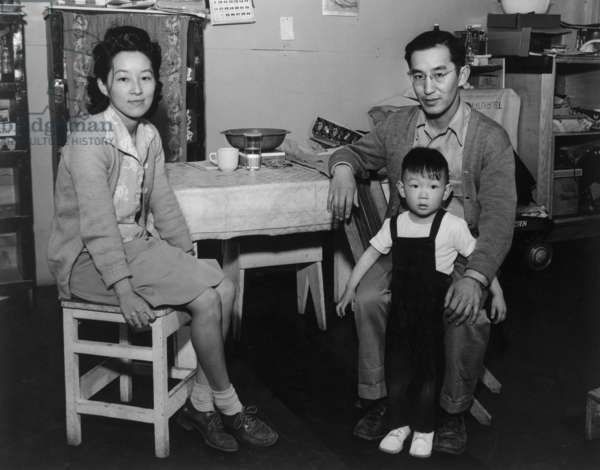Mr. and Mrs. Henry J. Tsurutani and baby Bruce, Manzanar Relocatioon Center, California, 1943 (photo)