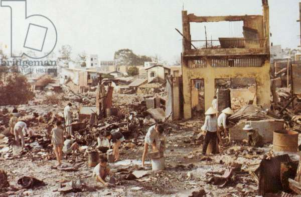 Civilians sort through the ruins of their homes in Cholon, the heavily damaged Chinese section of Saigon, Tet Offensive, Vietnam War, 1968 (photo)