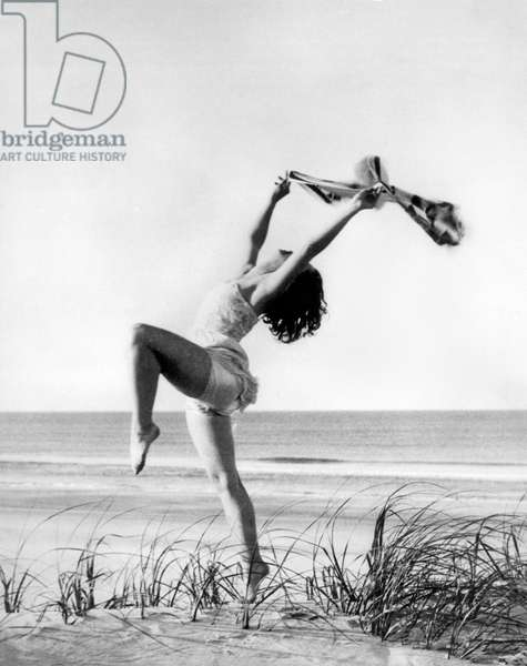 A Woman Dancing On The Shore (b/w photo)