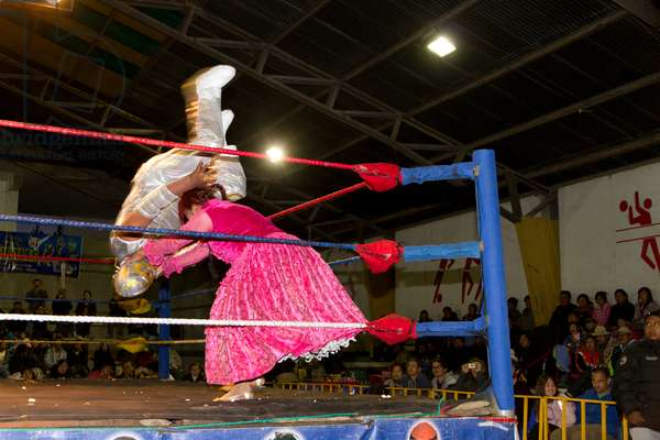 Male and female wrestlers in combat at the Cholitas Wrestling Event, El Alto, La Paz, Bolivia (photo)