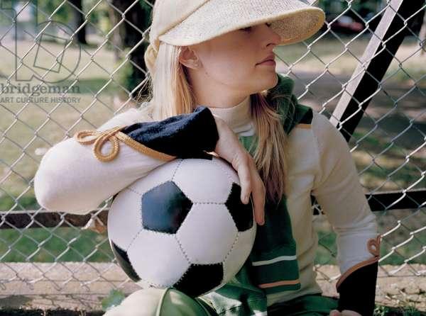 Portrait of a girl holding football, UK