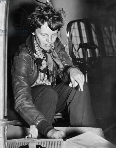 Amelia Earhart Checks Supplies (b/w photo)