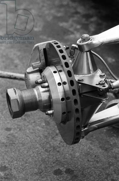 The front stub axle and disc brake of a Ferrari (b/w photo)