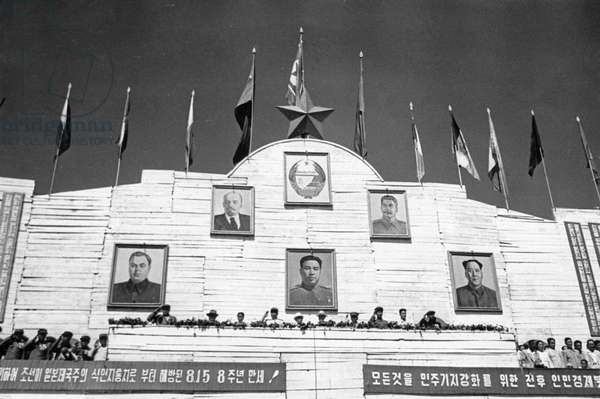 Marshal Kim Il Sung on the rostrum (4th from left) in the Central Square of Pyongyang, reviewing the Korean People's Army and other paraders during celebrations for the 8th Anniversary of Liberation, August 15, 1953