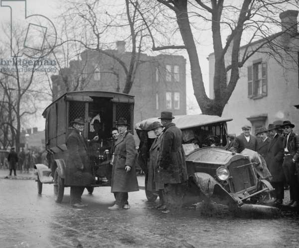 Bootleggers carted off to Prison after their Car was Wrecked in a Police Chase 1921 (photo)