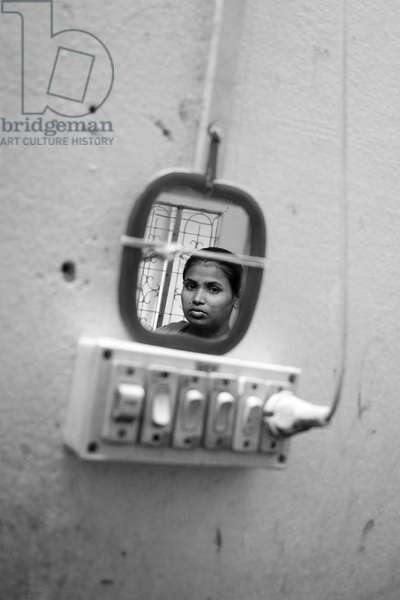 A moment of reflection. Garment workers do not even have the time to think. Dhaka, Bangladesh. July 7, 2006.  (photo)