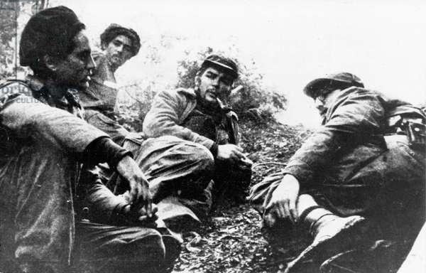 Cuban Revolution. Fidel Castro (Right) And Che Guevara (Center) In The Sierra Maestra.