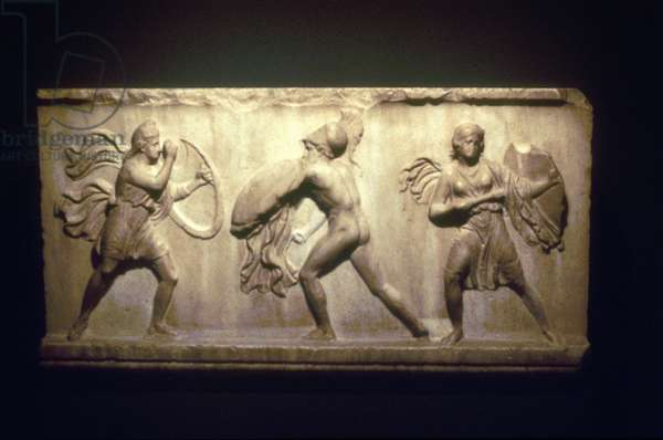 Greek warrior fighting Amazons, the female warriors . 8th-5th century BC. Limestone Relief