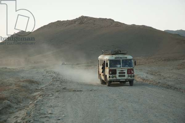 Bus Approaching Maidan Shar, Vardak Province, Afghanistan (photo)