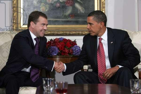 Dmitry Medvedev And Barack Obama Shake Hands At A Press Conference