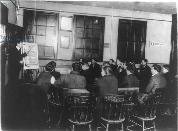 Department of Labor training service: Italian immigrants receiving instruction in English and citizenship, YMCA, Newark, NJ, USA. Photograph c1920-c1930.
