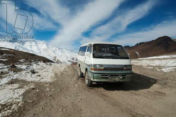 Minivan at the Hajigak Pass, Vardak Province, Afghanistan (photo)