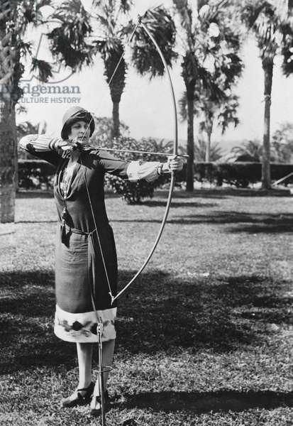 Woman Demonstrates A Longbow, Ormond Beach, Florida, February 9, 1926 (b/w photo)