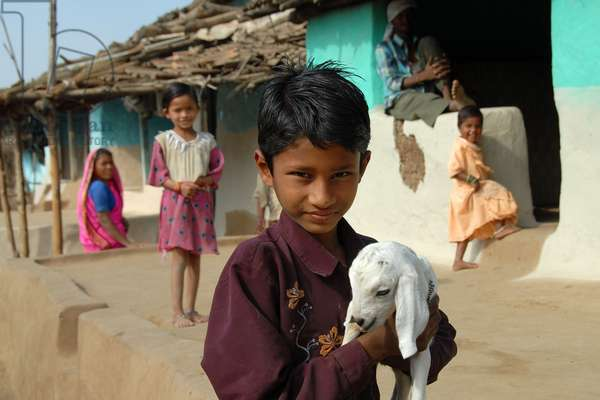 India: This young boy was playing with this very young goat. 10-Feb-07.  (photo)