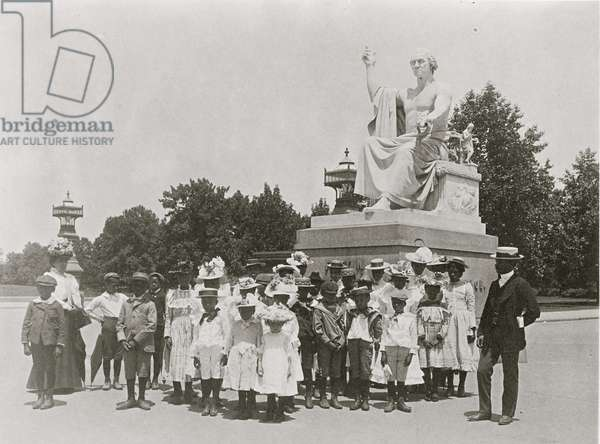 Group of school children in front of statue of George Washington, Washington, D.C. 1899 (photo)