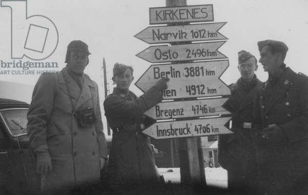 Soliders With a Sign Pointing to Berlin, 1942 (b/w photo)