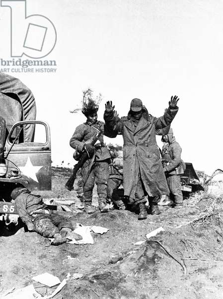 Korean War. Survivors of an American military unit surrendering to Chinese People's Volunteers. January 1951
