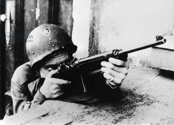 U.S. Soldier Fighting In Plzen, Czechoslovakia, In May 1945.