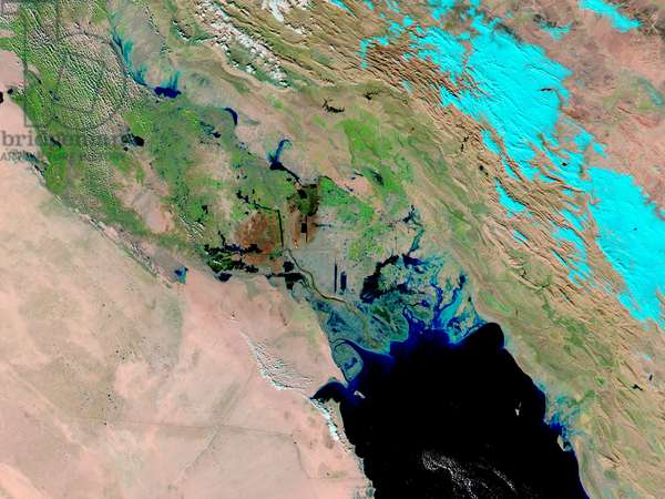 Winter rains and possibly melting snow from Iran's Zagros Mountains fill the marshes and shallow lakes of Southern and Eastern Iraq. Light blue is the snow-capped mountains in Iran. Credit NASA. Science Earth Geology
