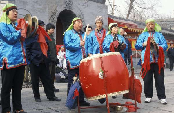 Musicians performing for the Dragon Dance at the New Year Temple Fair. Dongyuemiao. Beijing, China.
