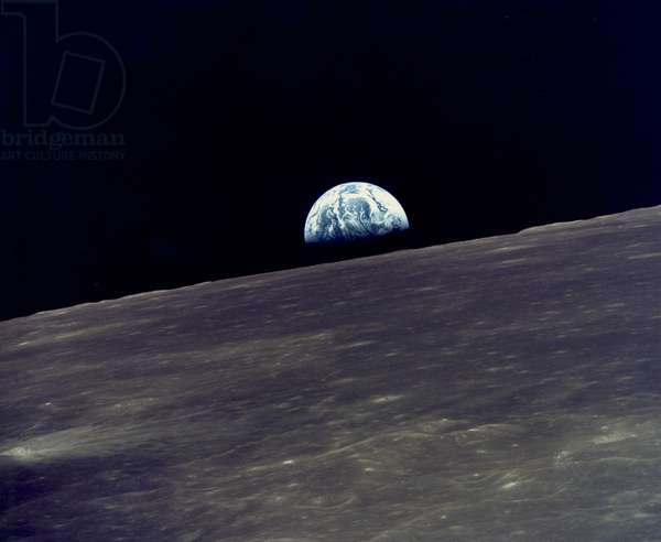 Moon: May, 1969 View of the earth rising above the lunar horizon photographed from the Apollo 10 Lunar Module, (Snoopy) as it orbited around the moon.  (b/w photo)
