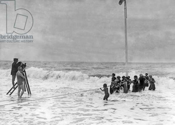Filming In The Surf, France, c.1922  (b/w photo)