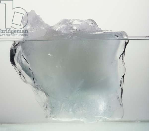 Block of ice in water.