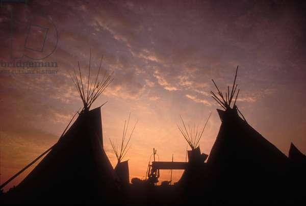 Sunset over the Teepee field, Glastonbury Festival, UK 1999.