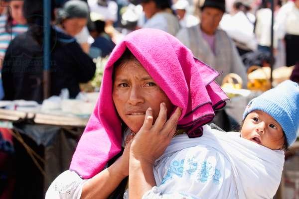 Otavaleno Woman Carrying A Baby, Otavalo, Imbabura, Ecuador (photo)