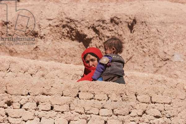Hazara Woman and Child in Bamiyan, Bamian Province, Afghanistan (photo)