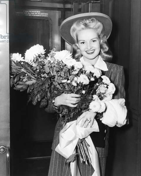 Betty Grable With Flowers, New York, New York, c.1942 (b/w photo)