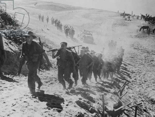 Soldiers Advancing off the Beach and Onto a Hill, 1942 (b/w photo)
