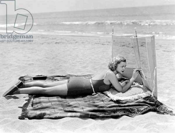 Woman With A Beach Screen (b/w photo)
